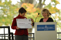 Laurie Liberatore (Historic Elmira, Inc.) accepts a check from Tania Werbizky (Preservation League of New York State).