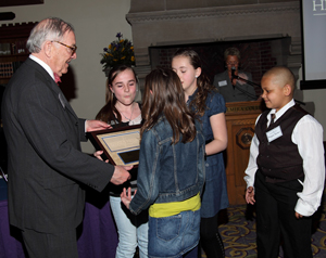 George L. Howell presents the Advocate Award to four student representatives from the Beecher Elementary School 2010 Fifth Graders for their �Learn and Serve� project benefiting historic preservation awareness and for raising funds for the Near Westside Neighborhood Association, Inc.